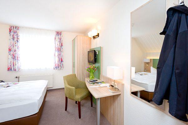 Einzelzimmer mit Seeblick in der Ferienpension in Neuensien auf der Insel Rügen